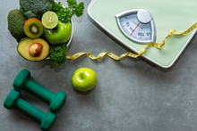 Diet And Healthy Life Concept. Green Apple And Weight Scale Measure Tap With Fresh Vegetable And Sport Equipment For Women Diet Slimming