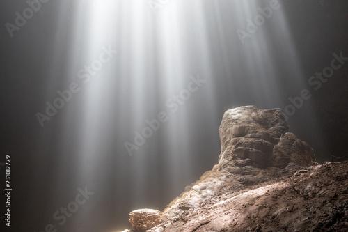 Fotografie, Obraz  Light rays shining on a rock inside cave Goa Jomblang in East Java, Indonesia