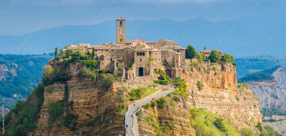 Fototapety, obrazy: The famous Civita di Bagnoregio hit by the sun on a stormy day. Province of Viterbo, Lazio, Italy.