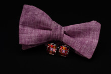 Pink Bow Tie With Colorful Cufflinks On Black