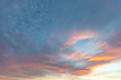 Dramatic colored sky at sunset. Moon and star in the clouds.