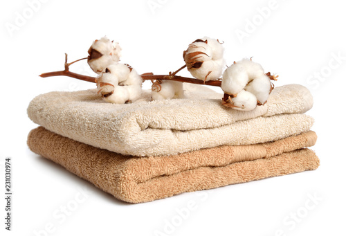 Fényképezés Branch of cotton and two baige cotton towels isolated on white background