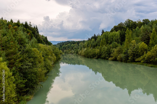 Papiers peints Riviere Forest river reflection landscape. Autumn forest river water panorama. Forest river reflection in autumn