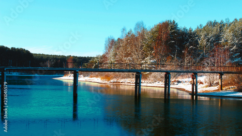 Spoed Foto op Canvas Turkoois Winter lake Bridge over lake forest snow beautiful nature great view