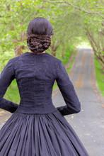 Dark-haired Victorian Woman In Black Ensemble