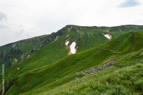 A magnificent panorama from the mountain range of Sancy, in Auvergne, France. National Park of the Auvergne volcano