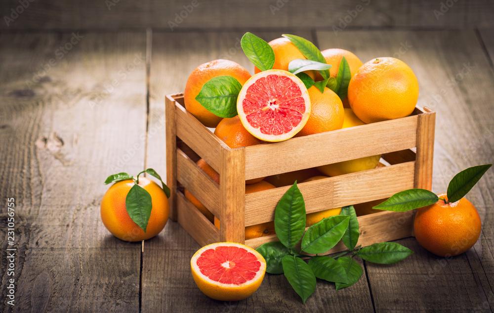 Fotografie, Obraz Fresh red grapefruit in the crate