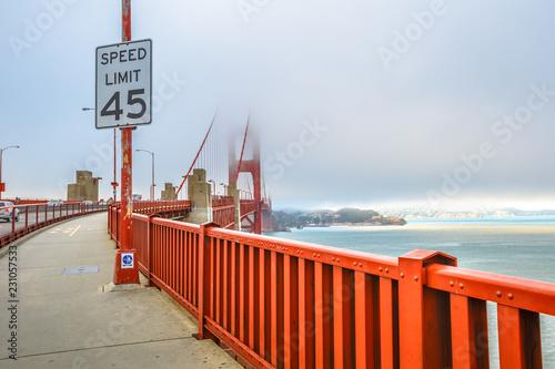 Golden Gate Bridge and popular red railing, San Francisco Bay, California, United States. Pedestrian perspective of bridge. Symbol and landmark of San Francisco. Travel and holidays concept.