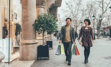 Asian Couple Shopping In Barce...