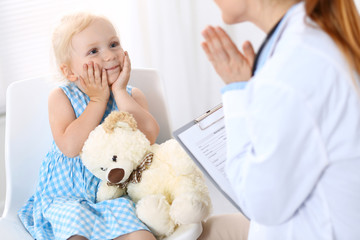 Doctor and a little blonde girl. Medicine and healthcare concept