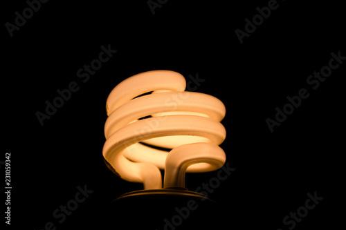 Close up of illuminated light bulb against dark background