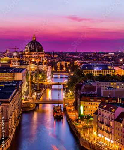 Poster Berlijn aerial view of Berlin skyline with Berlin Cathedral and Spree river in beautiful post sunset twilight during blue hour at dusk with dramatic colorful clouds , central Berlin Mitte, Germany