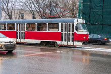 Red Tram Rides On The Road Sur...