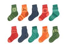 Warm Knitted Socks On White Ba...