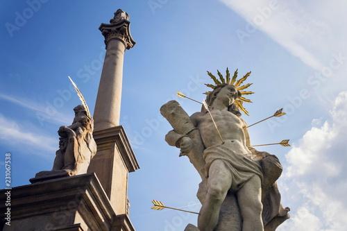 Cuadros en Lienzo Saint Sebastian shot with arrows martyr statue, Marian plague column of Saint Ro