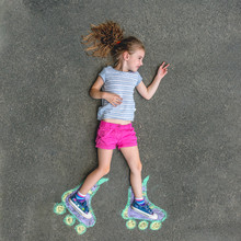 Sweet Girl In Roller Skates Painted With Chalk