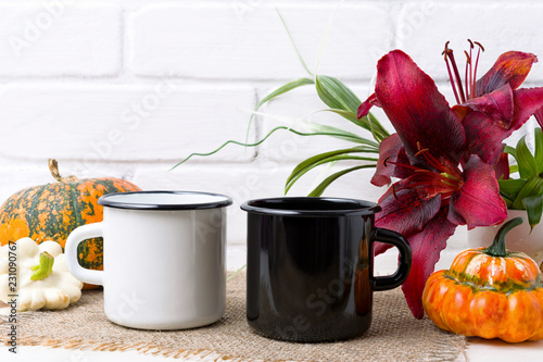White and black campfire mug mockup with pumpkin and red lily