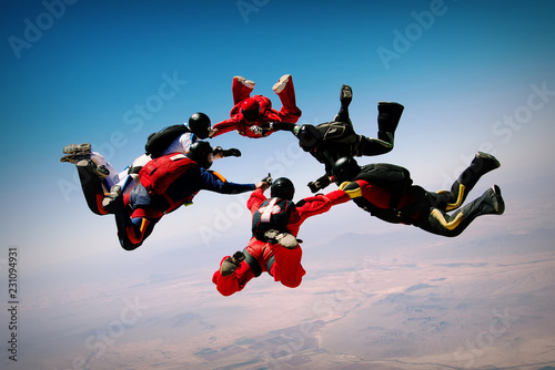 Fototapeta Skydiving teamwork formation