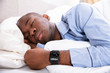 Man Sleeping With Smart Watch In His Hand