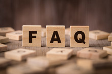 FAQ Sign With Wooden Background