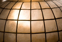 Light Coming Through Capiz Shell Lamp Shade. Capiz Shells Are Natural Seashells Found In The Warm Waters Off The Philippine Islands(also Known As Windowpane Oyster(Placuna Placenta)).