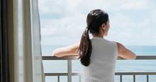 Woman Look At The Sea View At Balcony