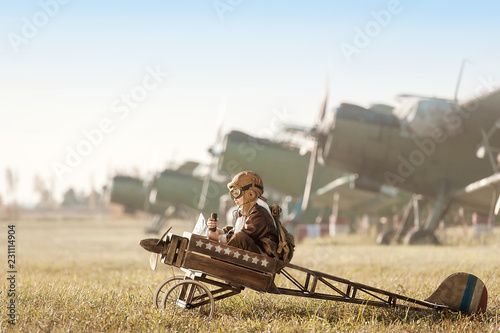 Portrait of the young aviator in a toy airplane child Canvas Print