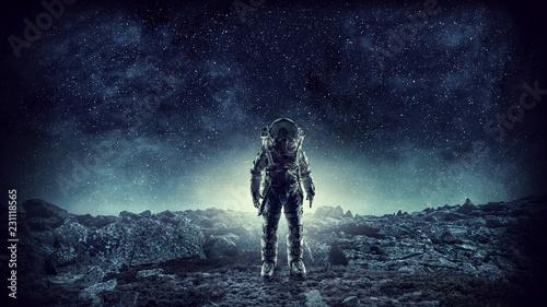 Fototapeta Spaceman landing planet. Mixed media obraz