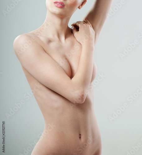 Keuken foto achterwand Akt Beautiful young woman with clean skin nude topless breasts. Beautiful woman covering her nude breast.