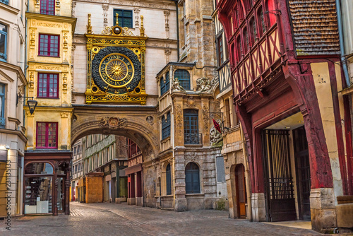 Spoed Fotobehang Europa old cozy street in Rouen with famos Great clocks or Gros Horloge of Rouen, Normandy,France