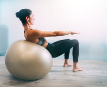 Woman Working Out With Exercis...