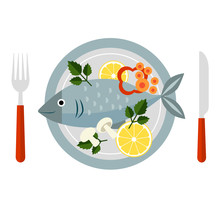 Cooked Fish And Raw Vegetables On A Plate