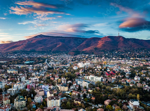 Beautiful drone shot of a vivid sunrise over Sofia, Bulgaria - impressive image with colourful skies and amazing aerial views over the city.
