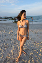 Young Beautiful Asian Woman Th...