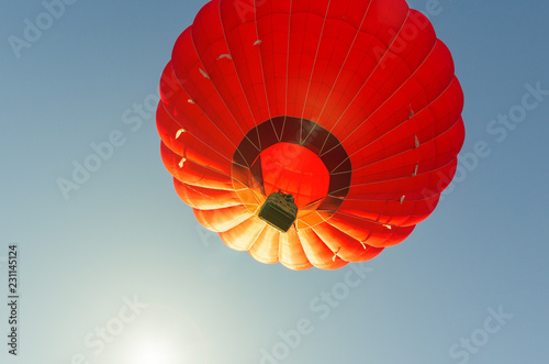 Spoed Foto op Canvas Luchtsport Colorful hot air balloon against the blue sky
