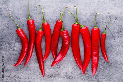 Poster Aromatische Chili cayenne pepper on grey background.