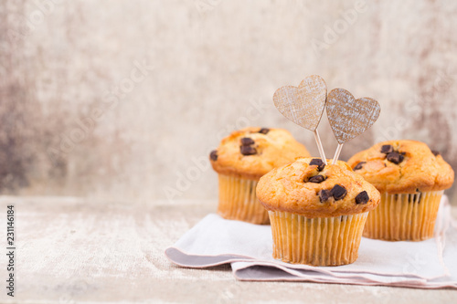 Fotografie, Obraz  Homemade chocolate muffins with heart, vintage background.