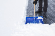 Man Cleaning Snow With Blue Sh...