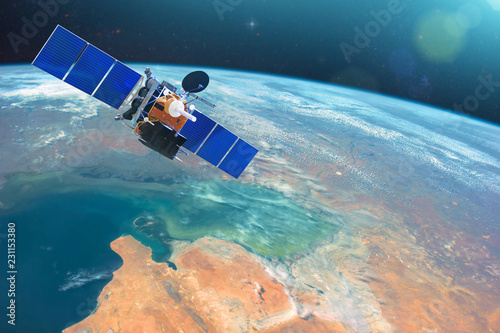 Obraz Space communications satellite in low orbit around the Earth. Elements of this image furnished by NASA. - fototapety do salonu