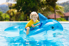 Child In Swimming Pool. Kid On Inflatable Float