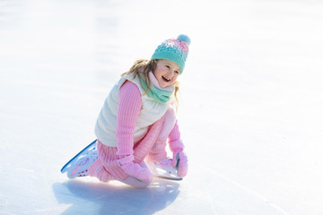 Child skating on natural ice. Kids with skates.