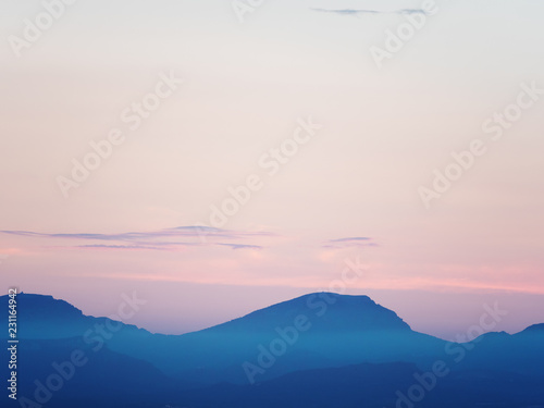 Spoed Foto op Canvas Groen blauw Mountain ranges by sunset