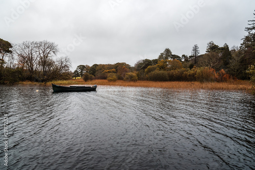 Foto op Canvas Zwart Scenic view of boat in lake in Killarney a misty day