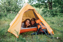 Young Couple Camping In Nature...