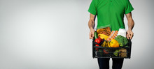 Food Delivery Service - Man With Groceries Box On Gray Background With Copy Space