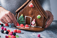 Young Man Making A Gingerbread House