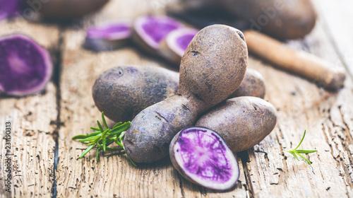 Fotografie, Obraz  Vitolette noir or purple potato. On a wooden background.