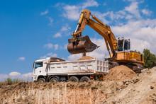 Excavator Loads Dump Truck Soi...