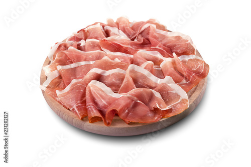 Photo sur Aluminium Assortiment Round chopping board with sliced Parma ham