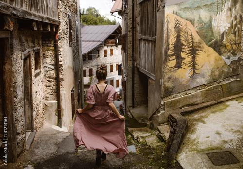 woman walking through old italian village